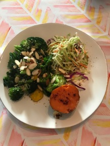 Sauteed broccoli, kale and asparagus, cabbage slaw with apple cider vinegar, and baked sweet potato